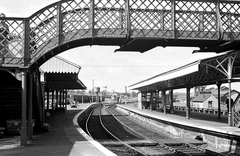 NEWPORT, Isle of Wight - This station replaced an earlier, much smaller one when the newly formed Isle of Wight Central Railway made its headquarters on the first floor of the station building. This view is looking north, with the island platform on the right and bay for Freshwater services on the left. Nothing now remains of this site at all.