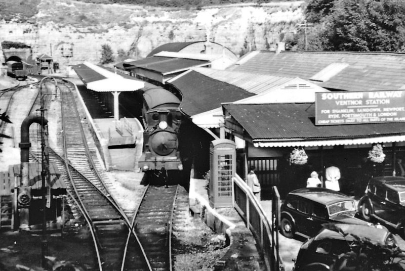 VENTNOR, Isle of Wight - The station was the terminus of the Isle of Wight Railway, opened in September 1866, on a very constricted site which allowed for virtually no development. Here we see it in SR days with Adams Class O2 tank No. W25 GODSHILL awaiting departure.