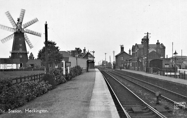 HECKINGTON - On the Sleaford - Boston section of the Grantham - Skegness line, opened in 1863 and still open today, with annual passenger figures of around 150,000. On the left is the signalbox with the unique 8 sailed windmill behind it. Seen here looking west.
