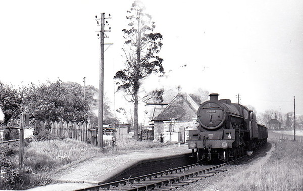 CRANFORD - lying between Thrapston and Kettering in Northamptonshire on the line from Cambridge - the station closed in 1956 although the line remained in situ from Kettering for iron ore traffic into the 1970's - seen here with 45660 ROOKE passing through on an iron ore trip for Kettering from Twywell in May 1965.