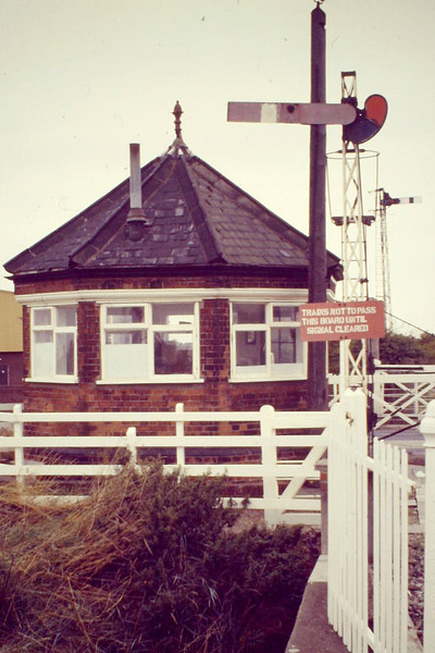 BOSTON - This little octagonal signal cabin stands by the landward end of the swingbridge with the GNR somersault signal protecting it, 09/88 - what a beautiful example of railway architecture! - and it's still there.