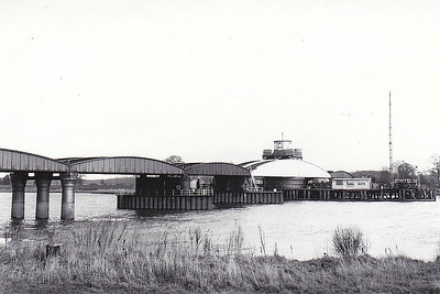 GOOLE SWING BRIDGE - Opened in 1869 across the River Ouse on the NER line to Hull and Doncaster. The bridge has 5 spans, four fixed while the 4th from the west swings to allow shipping access to the port Howdendyke just upriver. It has been hit by ships on a number of occasions: 21/12/73 - struck by German coaster VINETA (1766/81), causing one of the spans to fall into the river, leaving the bridge shut for nine months. 02/08/76, the Danish vessel LEON SIF (1329/67) hit one of the bridge's piers. British Rail began closure procedures for the railway line due to costs associated repairing the bridge's pier, estimated at £2 million, coupled with a historic failure to get adequate compensation for damage to the bridge caused by shipping. In 1987, the structure was given a Grade II* listing by English Heritage. 23/11/88, one of the fixed spans was pushed out of alignment by the Swedish vessel SAMO (2490/70), which became trapped between the bridge's piers. By the early 21st Century, understrength girders and corrosion had led to the line speed over the bridge being reduced to 60 mph for passenger trains, down to only 10 mph for most freightbtrains.  In 2009, a £6 million modernisation program began, resulting in a six-week closure.