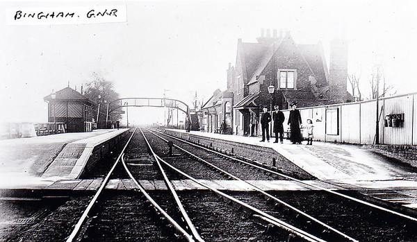 BINGHAM - Opened in July 1850 by the Ambergate, Nottingham, Boston and Eastern Junction Railway, the line soon passed into Great Northern hands. In 1879, the GNR/LNWR opened an adjacent station at Bingham Road on its line from Market Harbrough to Nottingham as it was unable to use the GNR station due to the layout of the extensive junction here. Bingham Road closed in 1951, just this station remaining open today, handling about 75000 passengers per year. Seen here looking east in about 1910.