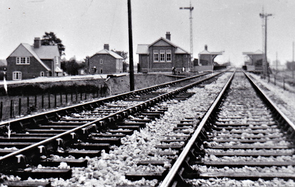 CONINGSBY - First station on the Woodhall Junction - Little Steeping cut-off line that allowed Lincoln trains direct access to Skegness without the need to run round at Boston. Built of timber on an embankment, closed to all traffic in October 1970. Seen here shortly after completion in July 1913 by the look of it.
