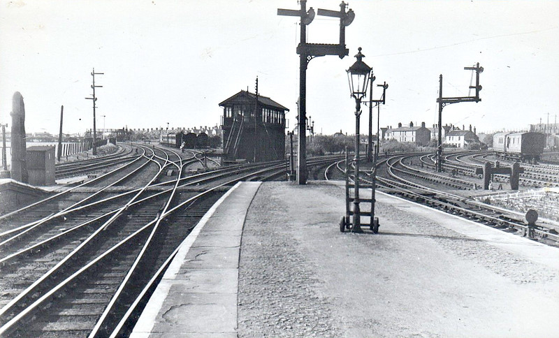 MARCH - Looking west from Platform 5 in the 1930's, at a guess, a view practically unrecognisable today. March North Signalbox is directly ahead whilst March West is visible just to the right of the tall signal, both now long gone. The bay platforms, 3 & 4, are both now filled in. Platforms 1 & 2, both still in situ, are now trackless. The Up and down Carriage Sidings are also long gone. The footbridge, known as Lilypond Bridge, is virtually invisible these days, the vegetation being so dense.