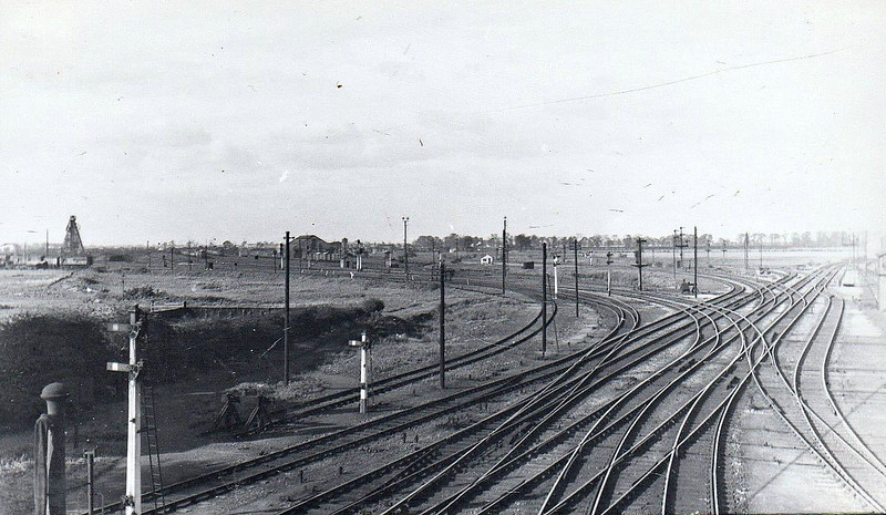 WHITEMOOR JUNCTION - A view looking north from Norwood Bridge in the 1940's, at a guess. Whitemoor Junction signalbox is just visible on the right with the Wisbech Branch going straight on past it. The next set of points lead to the Up Reception Sidings whilst the next double set are the GN/GE Joint line to Spalding. The last set lead into the loco depot, the cenotaph coaling tower visible above the breakdown train vehicles. I don't think a single piece of this exists anymore