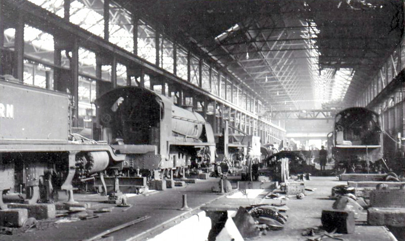 EASTLEIGH WORKS - some time in the 1940's I think. The tender loco on the left is a 'King Arthur', perhaps 805 SIR CONSTANTINE.