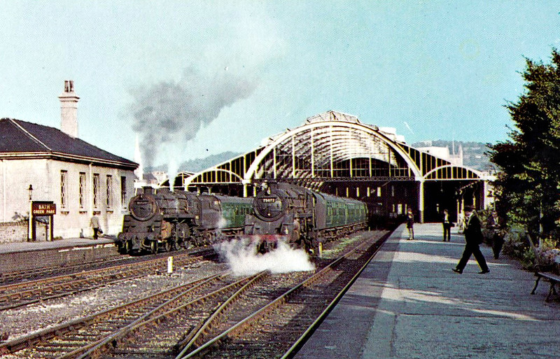 BATH GREEN PARK - Opened in May 1870 by the Midland Railway, the D&DJR joined them here in 1874. The station was called Queen's Square until 1954, when it was renamed Green Park. Passenger services ceased in 1966 and freight in 1971. A supermarket was built across the trackbed in 1982 and the listed station building is now used a market place and shopping centre. Seen here in October 1965, 76026 stands on the train to the left and 75072 on that to the right.