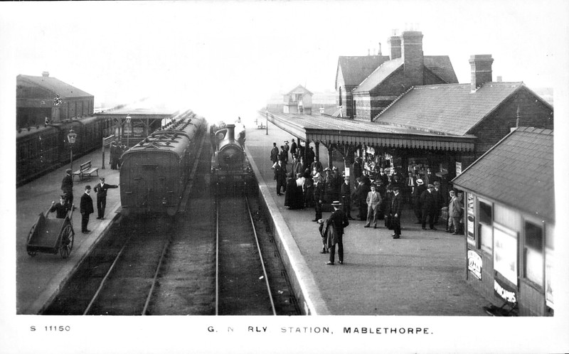 MABLETHORPE - opened in 1877 as a terminus from Louth, it became a through station in 1888 when the line was extended from Willoughby Junction in the south, forming the Mablethorpe Loop. As can be seen, the station was quite substantial with 2 through platforms, GNR 0-6-0 No.702 heading south through Platform 1, and 2 north facing bays, to the left of this shot. The line was very busy in the holiday season, with many specials running from the south via Willoughby Junction and during the 1950's passenger numbers were well over 100,000 annually. However, BR decided to close the line and the less used section from Mablethorpe to Louth Junction closed in December 1960. Despite assurances that the rest of the line would remain pen, it was doomed when BR announced its intention t close the Firsby Junction - Grimsby line and so the line closed in October 1970, only the line to Skegness remaining open.