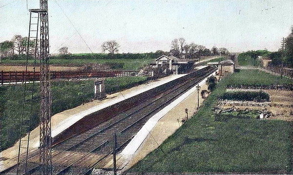 STICKNEY - opened in 1911 on the Woodhall Junction - Lttle Steeping line, closing for goods traffic in March 1964. The station closed completely when the whole line closed in October 1970. Seen here looking west from the road bridge and looking fresh from the box.