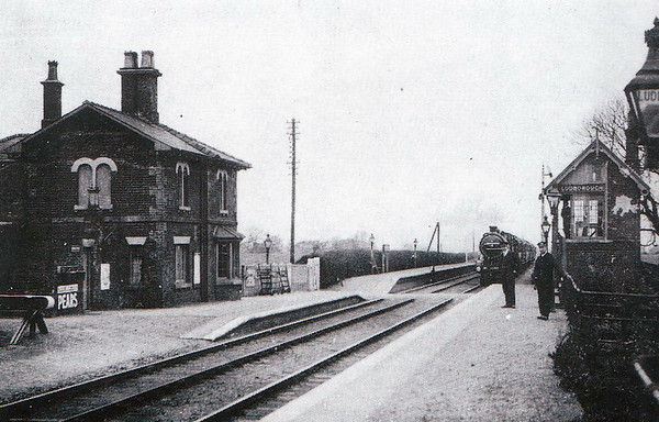 LUDBOROUGH - On the line from Grimsby to Louth, opened in 1848, closed to passengers in 1961 and completely in 1964, looking pretty desolate. However, it is now the base of the Lincolnshire Wolds Railway and sees plenty of activity. Seen here in early LNER days - note how the level crossing bisects the platform.