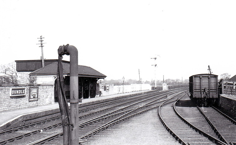 OUNDLE STATION - opened in 1845 on the Peterborough - Northampton line, with a substantial stone station building and staggered platforms. The station closed to regular traffic in 1964, remaining open for public school special trains until 1972. The building still exists as a residence. The westbound platform is seen here in the 1930's
