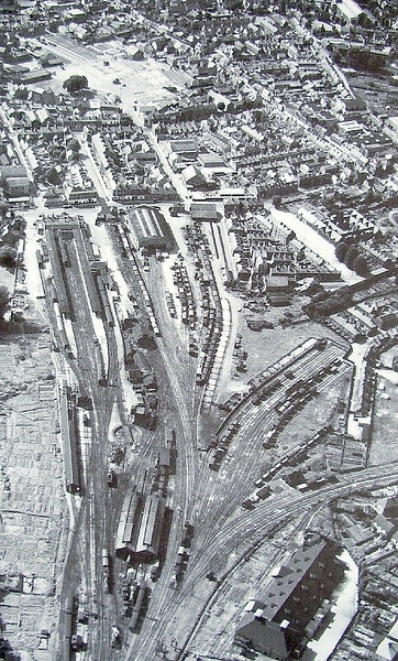KINGS LYNN - The station here bears little resemblance to what appears in this 1950 aerial view. Once the centre of a complicated web of railways, only the line to Cambridge now remains, although the original station buildings have been retained and tastefully restored. Much of the goods yard is now occupied by a retail park.