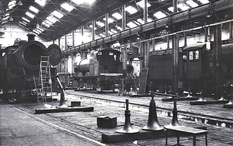 BOW WORKS - Built by the North London Railway in 1853, most of the NLR's locomotives were built there between 1860 and 1906. After merger with the LNWR in 1908, the works were reduced to repairs. From 1927, the LTSR fleet was also repaired here following the closure of Plaistow Works. The Works finally closed in 1960. Here we see 2-6-4T No.42328, 3F 0-6-0 No.43829 and J39 0-6-0 64951 under repair in September 1957.