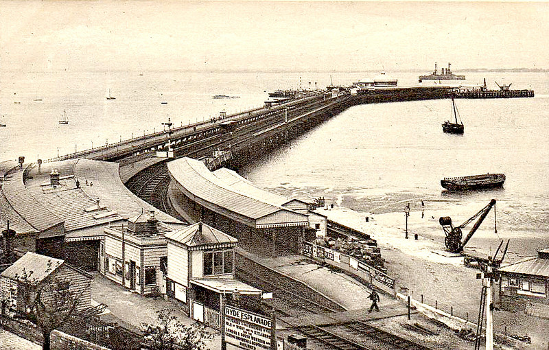 RYDE ESPLANADE STATION - situated at the landward end of the pier, Ryde Pierhead Station visible on the head of the pier. Judging by the Dreadnought anchored in the Solent, this picture is pre WW1.