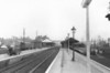 GRANTHAM - Seen here looking south from the Down Platform in the early 1960's, I guess, judging by the DMU in the bay platform and what looks like an A1 to the right of that. The depot is still open so it must be before 1963.