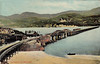 BARMOUTH BRIDGE - built in 1867, mainly of wood, the bridge is about 900 yards long and has a swing section at the near side. It still carries rail traffic along the Cambrian Coast Line. Posted April 1st,1910.
