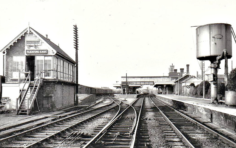 SLEAFORD - Looking west through the station from the level crossing in the late 1960's, showing all three platforms and a Grantham-bound DMU departing. East Signalbox is still operational, as are North, South and West, which must, I imagine, make Sleaford fairly unique on the current British railway scene.