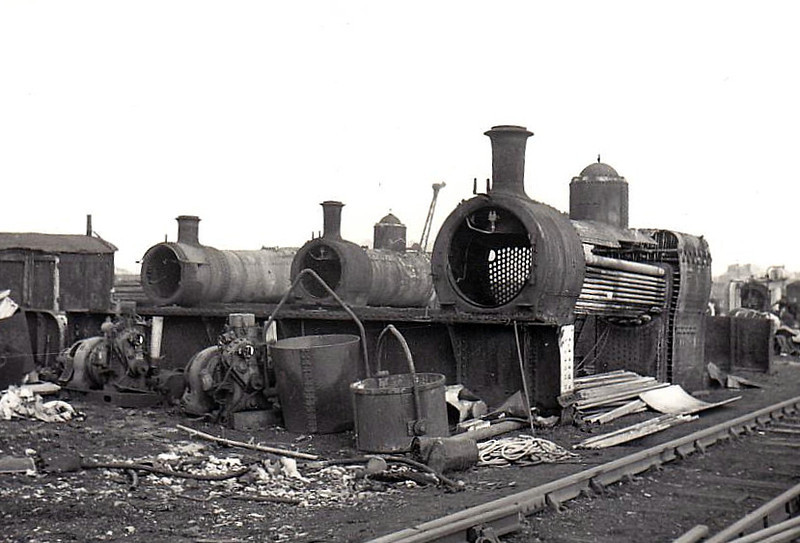 SCRAPPED LOCOMOTIVES - 3 engines reduced to nothing more than boilers, the one on the far left looking a little GWR whilst the two nearer look like classmates, possibly of MR origin.