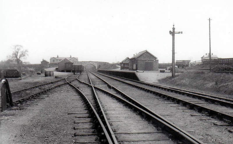 WALTHAM-ON-THE-WOLDS - Despite being in Leicestershire, the branch to Waltham was built by the Great Northern Railway in 1883 (note GNR somersault signals). The station never had a regular passenger service, being used only for specials until 1905, after which time it devoted its entire energy to the movement of iron ore until closure in 1964.
