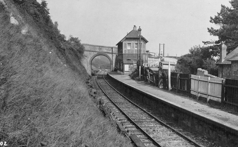 ST LAWRENCE - Opened in July 1897 by the Newport, Godshill & Ventnor Railway, this was the first stop out of Ventnor Town. The station was built wedged into the cliff side with a small goods yard beyond the bridge. In 1927 it was reduced to an unstaffed halt and closed in September 1952.