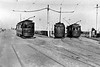 IMMINGHAM TOWN - Tram No.10 has just arrived from Immingham Dock via the railway overbridge, It will reverse here and then continue to Grimsby via the left of the two tracks diverging to the right, currently occupied by No.14. No.12 is just arriving from Grimsby. Seen here in the mid 1930's.