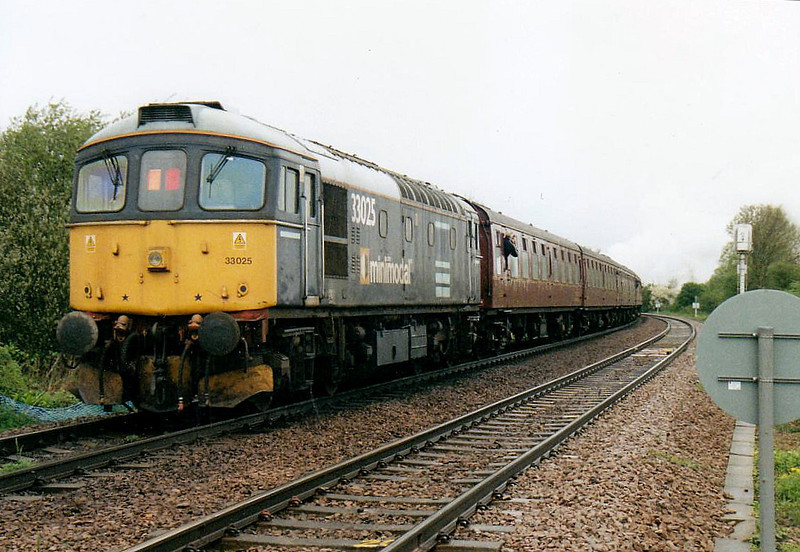 RAIL TOUR - 'LINCOLN EXPLORER' - organised by the Railway Touring Company and run on  May 1st, 2006. 33025, in DRS Minimodal livery, is on the rear at Badgeney Road LC, 61264 providing power on the way there, 33025 coming back. The tour ran as follows:-<br /> <br /> 61264 - Norwich - Wymondham - Brandon - Ely North Jn - Ely West Jn - March - Whittlesea - Peterborough - Peterborough Yard - New England North Jn - Werrington Jn - Spalding - Sleaford - Metheringham - Lincoln Central<br /> 33025 - Lincoln Central - (reverse of outward route) - Norwich