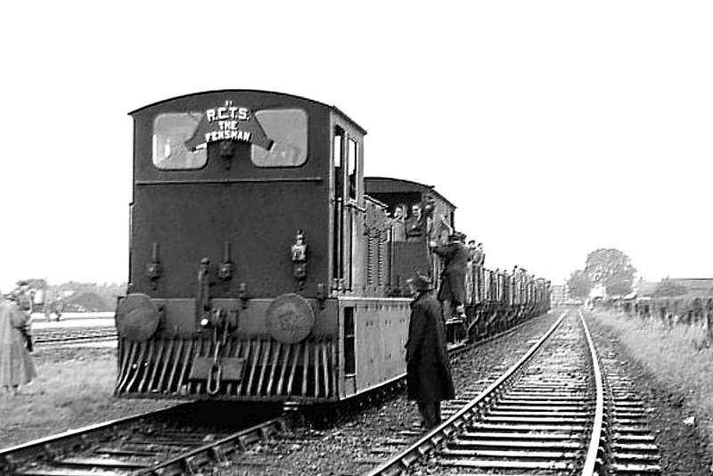RAIL TOUR - 'FENSMAN No.2' (4) - 11102 - Drewry 0-6-0 DM Shunter - built 06/52 by Drewry & Co.  - 01/58 to D2202 - withdrawn 02/68 withdrawn from Crewe Works - this was a 31B loco from new to September 1966 - seen here 'suited and booted' at Upwell Depot on the Tramway leg of the 'Fensman No.2' Rail Tour on September 9th, 1956.