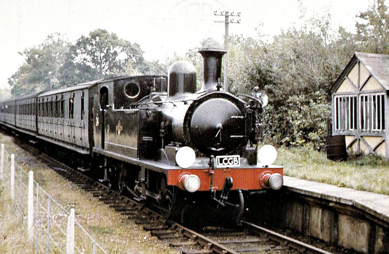 RAIL TOUR - 'VECTIS RAIL TOUR' - organised by the LCGB ad run on October 3rd, 1965. W24 CALBOURNE is seen here at Whippingham. The tour ran as follows:-<br /> <br /> 34002 - London Waterloo - Epsom - Horsham - Chichester<br /> 33027/33020 - Chichester - Lavant<br /> 33020/33027 - Lavant - Chichester<br /> 34002 - Chichester - Portsmouth Harbour<br /> Boat - Portsmouth - Ryde<br /> W24- Ryde Pier Head - Ryde Esplanade - Smallbrook Jn - Haven Street - Newport - Cowes - Newport - Haven Street - Smallbrook Jn - Ryde Esplanade - Ryde Pier Head<br /> W24/W14 - Ryde Pier Head - Ryde Esplanade - Smallbrook Jn - Sandown - Shanklin - Ventnor<br /> W14/W24 - Ventnor - Shanklin - Sandown - Smallbrook Jn - Ryde Esplanade - Ryde Pier Head<br /> Boat - Ryde - Portsmouth<br /> 73155 - Portsmouth Harbour - Guildford - London Waterloo