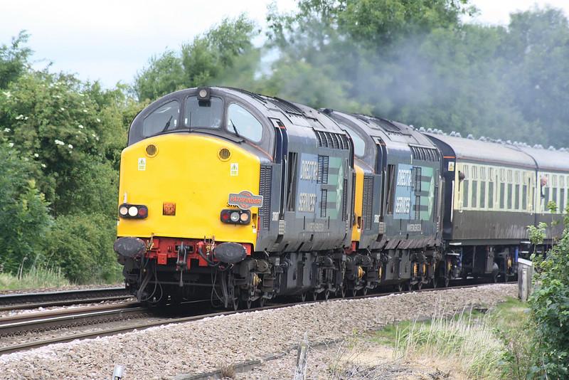 RAIL TOUR - 'NORFOLK EXPLORER' - organised by Pathfinder Railtours and run on July 8th, 2015. 37607 leads 37612 approaching Silt Road LC, March, 08/07/15. The tour ran as follows and included runs over the Mid-Norfolk Raiway:-<br /> <br /> 37607/37612 - Bristol Parkway - Westerleigh Jn - Yate - Cam & Dursley - Standish Jn - Gloucester Yard Jn - Barnwood Jn - Cheltenham Spa - Ashchurch - Abbotswood Jn - Norton Jn - Worcester Shrub Hill - Droitwich Spa - Stoke Works Jn - Bromsgrove - Barnt Green - Kings Norton - Lifford East Jn - Bordesley Jn - St Andrews Jn - Landor Street Jn - Water Orton - Coleshill Parkway - Whitacre Jn - Nuneaton - Hinckley - Wigston North Jn - Leicester - Syston South Jn - Syston East Jn - Melton Mowbray - Oakham - Manton Jn - Stamford - Peterborough - March - Ely<br /> 37059 - Ely - Brandon - Thetford - Wymondham<br /> 37607/37612 - Wymondham - Thuxton - Yaxham - Dereham - Hoe<br /> 37059 - Hoe - Dereham - Yaxham - Thuxton - Wymondham<br /> 37607/37612 - Wymondham - Thetford - Brandon - Ely North Jn - Ely West Jn - March - Peterborough<br /> 37607/37612 - Peterborough - (reverse of outward route) - Bromsgrove - Stoke Works Jn - Abbotswood Jn - (reverse of outward route) - Bristol Parkway