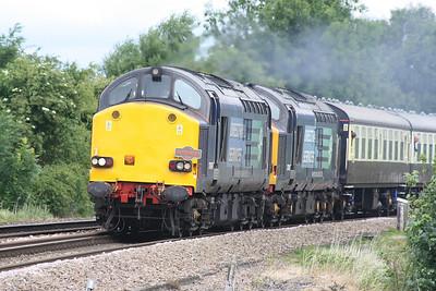 RAIL TOUR - 'NORFOLK EXPLORER' - organised by Pathfinder Railtours and run on July 8th, 2015. 37607 leads 37612 approaching Silt Road LC, March, 08/07/15. The tour ran as follows and included runs over the Mid-Norfolk Raiway:-  37607/37612 - Bristol Parkway - Westerleigh Jn - Yate - Cam & Dursley - Standish Jn - Gloucester Yard Jn - Barnwood Jn - Cheltenham Spa - Ashchurch - Abbotswood Jn - Norton Jn - Worcester Shrub Hill - Droitwich Spa - Stoke Works Jn - Bromsgrove - Barnt Green - Kings Norton - Lifford East Jn - Bordesley Jn - St Andrews Jn - Landor Street Jn - Water Orton - Coleshill Parkway - Whitacre Jn - Nuneaton - Hinckley - Wigston North Jn - Leicester - Syston South Jn - Syston East Jn - Melton Mowbray - Oakham - Manton Jn - Stamford - Peterborough - March - Ely 37059 - Ely - Brandon - Thetford - Wymondham 37607/37612 - Wymondham - Thuxton - Yaxham - Dereham - Hoe 37059 - Hoe - Dereham - Yaxham - Thuxton - Wymondham 37607/37612 - Wymondham - Thetford - Brandon - Ely North Jn - Ely West Jn - March - Peterborough 37607/37612 - Peterborough - (reverse of outward route) - Bromsgrove - Stoke Works Jn - Abbotswood Jn - (reverse of outward route) - Bristol Parkway