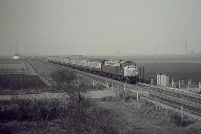 RAIL TOUR - 'WHISTLER FINALE' - organised by TP Railtours and run on March 9th, 1985. 40122, ex D200, approaches the A141 Bridge on this tour to mark the end of Class 40 in regular traffic. The tour ran as follows:-  D200 - York - Church Fenton - Micklefield - Cross Gates - Leeds - Gelderd Road Jn - Wakefield Westgate - South Kirkby Jn - Doncaster - (via ECML) - Grantham - Peterborough - Whittlesea - March - Ely - Chippenham Jn - Bury St Edmunds - Ipswich - Harwich Parkstone Quay - Manningtree - Colchester - Chelmsford - Stratford - approx 1/4 mile short of London Liverpool Street (to avoid run round in station and allow D200 to go for fuel). 31225 - approx 1/4 mile short of London Liverpool Street - London Liverpool Street D200 - London Liverpool Street - Bethnal Green - Hackney Downs - Clapton Jn - Cheshunt - Broxbourne - Cambridge - Ely - (reverse of outward route) - Grantham (missed Grantham stop and had to reverse about 1 mile) - (reverse of outward route) - York.