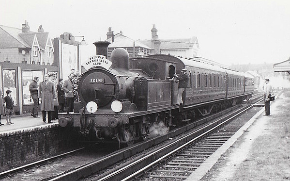 RAIL TOUR - 'SOUTH LONDON RAIL TOUR' - organised by the REC and run on March 31st, 1962, with 30199 as power throughout and seen here at Shepperton. The tour ran as follows:-  London Waterloo - Clapham Junction - Twickenham - Kingston - Sunbury - Shepperton - Sunbury - Strawberry Hill - Twickenham - South Acton - Kew East Ju - Kew New Jn - Clapham Junction - Longhedge Jn - Factory Jn - Brixton - Herne Hill - Tulse Hill - West Norwood - Crystal Palace - Norwood Junction - Selhurst - Clapham Junction -  Longhedge Jn - Stewarts Lane Jn - London Victoria (E)