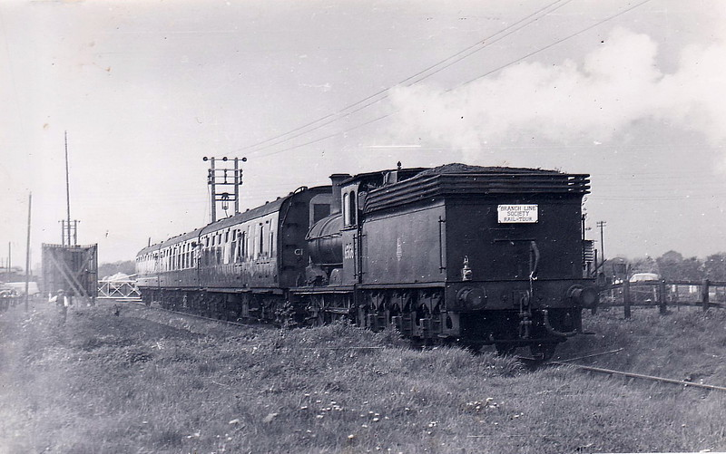 RAIL TOUR - 'DERWENT VALLEY LIGHT RAILWAY' - organised by the Branch Line Society and run on May 17th, 1958. 65064 was the sole motive power and is seen here at Dunnington on May 17th, 1958, on the outward journey. The tour ran as follows:-<br /> <br /> York Layerthorpe - Elvington - Cliff Common - Elvington - York Layerthorpe