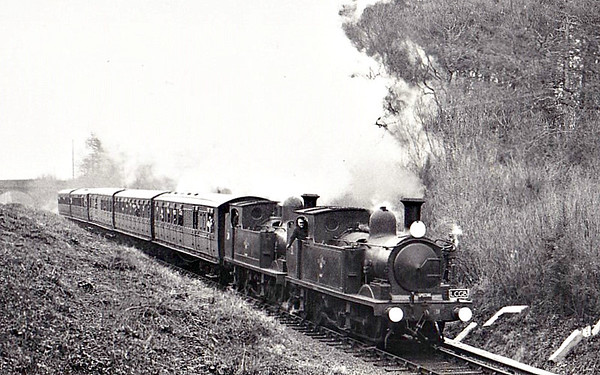 RAIL TOUR - 'ISLE OF WIGHT STEAM FAREWELL' - organised by the LCGB and run on December 31st, 1966. W31 CHALE is seen here piloting W24 CALBOURNE near Brading. The tour ran as follows:-  73065/73043 - London Waterloo - Clapham Junction - Hampton Court Jn - Woking - Guildford - Haslemere - Petersfield - Havant - Portcreek Jn - Portsmouth & Southsea - Portsmouth Harbour MV Southsea - Portsmouth Harbour - Ryde Pier Head W24/W31 - Ryde Esplanade - Brading - Sandown - Shanklin - Sandown - Brading - Ryde Esplanade MV Brading - Ryde Pier Head - Portsmouth Harbour 34013 - Portsmouth Harbour - Portsmouth & Southsea - Portcreek Jn - Havant - Chichester - Arundel Jn - Horsham - Dorking North - Epsom - Raynes Park - Clapham Junction - London Waterloo