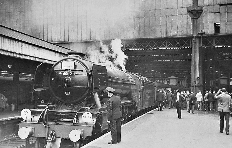 RAIL TOUR - 'SOUTHERN COUNTIES ENTERPRISE' - organised by the Southern Counties Touring Society and run on August 25th, 1963. 60112 ST SIMON is seen here at Waterloo. The tour ran as follows:-<br /> <br /> 60112 - London Waterloo - Clapham Jn Earlsfield - Wimbledon - Surbiton - Woking - Basingstoke - Winchester City - Eastleigh - Southampton Central - Brockenhurst - Bournemouth Central - Poole - Hamworthy Jn<br /> 30052 - Hamworthy Jn - Hamworthy - Hamworthy Jn<br /> 60112 - Hamworthy Jn - Wareham - Dorchester South - Weymouth Jn<br /> 7782/4689 - Weymouth Jn - Melcombe Regis - Portland - Easton<br /> 4689/7782 - Easton - Portland - Melcombe Regis - Weymouth Jn (1) - Dorchester West - Maiden Newton - Bridport - West Bay<br /> 7782/4689 - West Bay - Bridport - Maiden Newton<br /> 60112 - Maiden Newton - Yeovil Pen Mill - Westbury - Warminster - Salisbury - Andover Jn - Basingstoke - (reverse of outward route) - London Waterloo