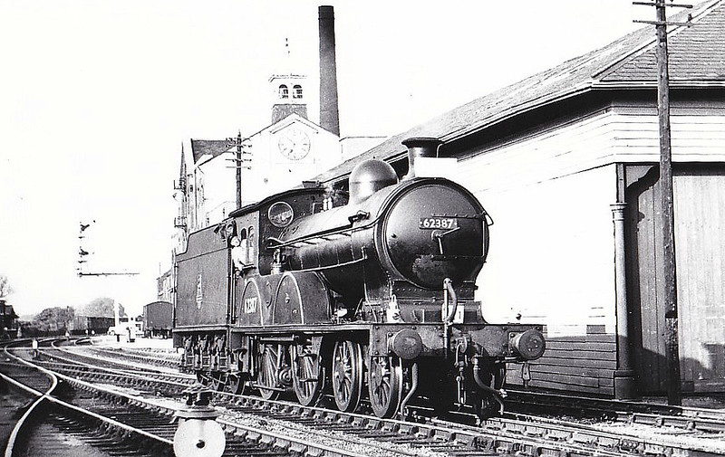 RAIL TOUR - 'YORKSHIREMAN' - organised by the Branch Line Society and run on June 2nd, 1957. 62387 is seen here at Malton. The tour ran as follows:-<br /> <br /> 62387 - York - Alne<br /> 68726 - Alne - Easingwold - Alne<br /> 62387 - Alne - Sessay Wood Jn - Pilmoor - Sessay Wood Jn - Sunbeck Jn - Gilling - Helmsley - Kirbymoorside - Kirbymoorside - Helmsley - Gilling - Barton-le-Street - Scarborough Road Jn - Wetwang - Driffield West Jn - Driffield - Driffield West Jn - Middleton-on-the-Wolds - Market Weighton - Holme Moor - Cliff Common - Barlby Jn - Selby - (via ECML) - York