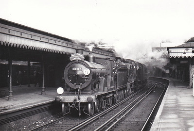 RAIL TOUR - 'ASHFORD AND EASTLEIGH WORKS' - organised by Ian Allan Ltd. and run on April 12th,1961. This was re-run of a previously over-subscribed tour. 30117 is seen here piloting Class D1 31749. These two locos worked the train from Charing Cross to Redhill via Ashford. The tour ran as follows:-  30117/31749 - London Charing Cross - Maidstone East - Ashford- Tonbridge - Redhill 30909 - Redhill - Guildford - Woking 30913 - Woking - Eastleigh - Eastleigh Works  - (via SW mainline) - London Charing Cross