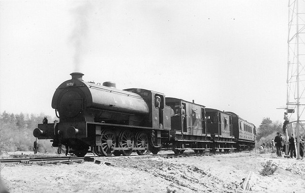 RAIL TOUR - 'LONGMOOR RAIL TOUR' - organised by RCTS (London Branch) on April 30th, 1966 - here we see WD196 hauling the tour. The tour ran as follows:-  31791/31639 - London Waterloo - Hampton Court Jn - Woking WD600 - Woking - Guildford - Haslemere - Liss WD195 - Liss (BR) - Longmoor Downs WD196 - Longmoor Downs - Hollywater Loop - Longmoor Downs WD878 - Longmoor Downs - Hollywater Loop - Longmoor Downs WD196 - Longmoor Downs - Whitehill - Bordon WD600 - Bordon - Bentley - Ash Vale - Ascot - Staines - Staines Loop 73114 - Staines Loop - Staines - Windsor & Eton Riverside 31791/31639 - Windsor & Eton Riverside - Staines - Hounslow - London Waterloo