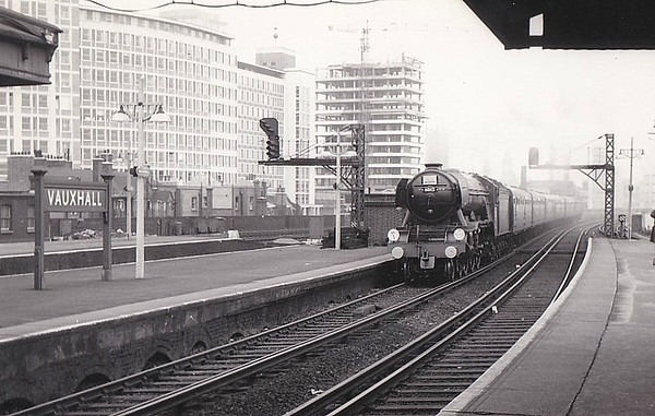 RAIL TOUR - 'SOUTHERN COUNTIES ENTERPRISE' - organised by the Southern Counties Touring Society and run on August 25th, 1963. 60112 ST SIMON is seen here at Vauxhall. The tour ran as follows:-  60112 - London Waterloo - Clapham Jn Earlsfield - Wimbledon - Surbiton - Woking - Basingstoke - Winchester City - Eastleigh - Southampton Central - Brockenhurst - Bournemouth Central - Poole - Hamworthy Jn 30052 - Hamworthy Jn - Hamworthy - Hamworthy Jn 60112 - Hamworthy Jn - Wareham - Dorchester South - Weymouth Jn 7782/4689 - Weymouth Jn - Melcombe Regis - Portland - Easton 4689/7782 - Easton - Portland - Melcombe Regis - Weymouth Jn (1) - Dorchester West - Maiden Newton - Bridport - West Bay 7782/4689 - West Bay - Bridport - Maiden Newton 60112 - Maiden Newton - Yeovil Pen Mill - Westbury - Warminster - Salisbury - Andover Jn - Basingstoke - (reverse of outward route) - London Waterloo