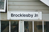 BROCKLESBY JUNCTION - The sign on the platform level signalbox - I was there on August 25th, 1998. The lines to Immingham and Grimsby diverge here.