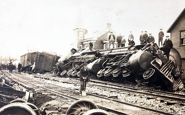 AMERICAN MALLETT - No information on this picture at all but fairly spectacular nonetheless. It looks as though this 2-8-8-2 loco has spread the rails. I bet the people in the house on the right got a bit of a fright!