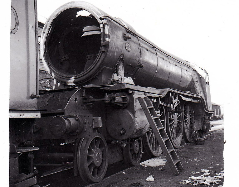 CASTLECARY - 2744 GRAND PARADE - Gresley LNER Class A1 4-6-2 - built 08/28 by Doncaster Works - 12/37 withdrawn after Castlecay accident - seen here at Doncaster Works after the accident.<br /> <br /> On December 10th, 1937, at 1637, the 1603 Edinburgh Waverley to Glasgow Queen Street express train collided at Castlecary station with the late-running 1400 express train from Dundee to Glasgow Queen Street on the Edinburgh to Glasgow main line of the LNER, killing 35 people. At the time of the accident, whiteout conditions prevailed due to a snowstorm. The Edinburgh train hit the rear of the standing Dundee train at an estimated 70 mph. Due to the confines of the location, the rear four coaches of the Dundee train were completely disintegrated. The engine of the Dundee train, LNER Class D29 no. 9896 DANDIE DINMONT, was pushed forward 100 yards with the brakes on. The locomotive of the Edinburgh train, LNER Class A3 no. 2744 GRAND PARADE was damaged beyond repair (and was replaced by a new engine with the same number and name in April 1938). The death toll was 35 (including 7 train crew) and 179 people were hurt, most of them seriously. An eight-year-old girl was counted as missing. The driver of the Edinburgh train was committed to court on a charge of culpable homicide for supposedly driving too fast for the weather conditions, but the charge was dropped. The Inspecting Officer concluded that it was the signalman who was principally at fault for the disaster. The whiteout meant that visibility was no more than a few yards and so the signalmen on this stretch of line were operating Regulation 5e. This meant that a double section had to be clear ahead for a train to be signalled to pass the previous box, Greenhill Junction. A set of points ahead had been blocked by snow and caused several trains to back up and the Castlecary home signal was therefore at 'danger'. The Dundee train ran past that signal in poor visibility but managed to stop just beyond it. The Castlecary