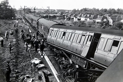 PITSEA - (2) On April 18th, 1961, the 12:25 Fenchurch Street to Shoeburyness service, which was carrying around 150 passengers, was travelling on the Up line in the Down direction; the line at the time of the incident was being worked as single only part way between Laindon and Pitsea due to the then ongoing electrification engineering work. At around 1:34 pm confusion involving the catch points resulted in Class 4 2-6-4T No. 80075 being derailed along with the first four coaches of the eleven coach train. The locomotive ended up on its side leading to extensive damage to the first four carriages causing the death of two passengers and injuries to forty six others. The following day in the house of commons the Minister of Transport Ernest Marples in response to a question from the MP for Billericay Edward Gardner gave a detailed statement of the tragic events. He made note that an emergency bus service was in operation between Pitsea and Laindon and that rush hour trains were diverted via Tilbury to all stops beyond Pitsea. Normal services had resumed by Wednesday 19th July.