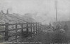 CUDWORTH - On January 19th, 1905, in thick fog, the 2.25 a.m. up mail train (Leeds to Sheffield) was travelling between Cudworth and Darfield stations, when the 3.5 a.m. up express train (Leeds to St. Pancras) running at high speed passed signals at danger and overtook it. The wreckage caught fire and virtually the entirety of both trains was consumed. Four passengers, a railway guard and a fireman, all of whom were in the express, were killed on the spot. Thirteen passengers, of whom one later died from the effects of injuries received, and five railway employees suffered more or less severely from shock or injury.