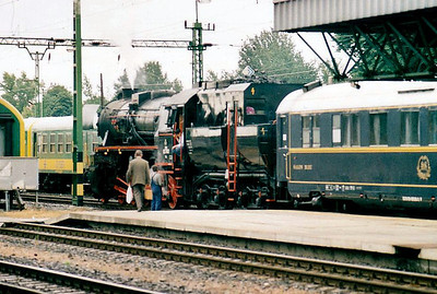 BRENNER & BRENNER - 52 7612 - 2-10-0 'Krieglok', built 1942 to 1945, in private ownership - seen here arriving at Sopron with a rake of Wagon Lits ecs, 07/06/02. Note tender cab for running tender first on lines with no turning facilities.