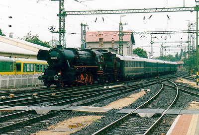 BRENNER & BRENNER - 52 7612 - 2-10-0 'Krieglok', built 1942 to 1945, in private ownership - seen here arriving at Sopron with a rake of Wagon Lits ecs, 07/06/02.
