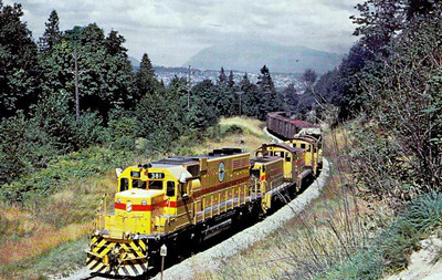 BRITISH COLUMBIA HYDRO RAILWAYS - 381 - a Class SD38 loco leads three class SW1200's up Kennedy's Hill near New Westminster, Ontario, in 1972.