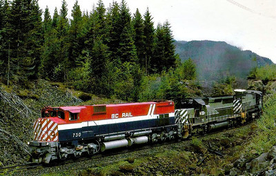 BC RAIL - 730 - an M630 Class loco, built by Montreal Locomotive Works in 1973, resplendent in its new livery, is trailed by SD40 No.752 and M630 No.726, both in old livery, on a southbound freight near Whistler, BC, in May 1986.