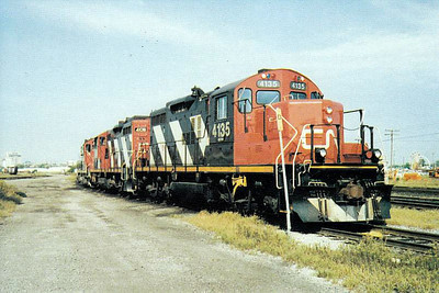 CANADIAN NATIONAL RAILROAD - 4135 - and sister Class GP9 loco no.4108 sit with a third in the yard at London, Ontario, in 1990.